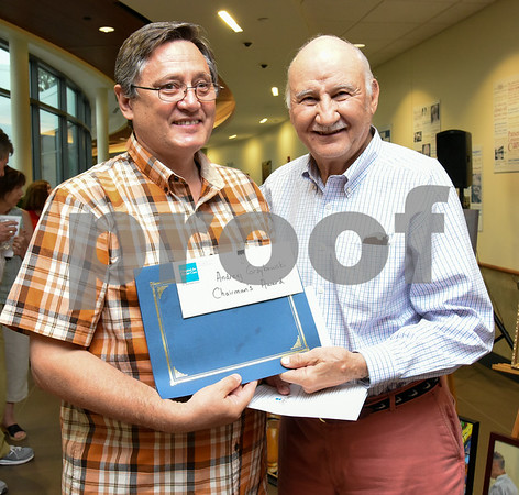 072017 Wesley Bunnell | Staff The Hospital for Special Care held their 14th Annual Juried Art Show on Thursday evening with an exhibition running until September 28th. Andrzej Grzybowski receives his Chairmans Award from the Chairman Sam Paul.
