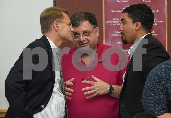 072017 Wesley Bunnell | Staff The Democratice Town Committee endorsed its slate of candidates for Novembers municipal elections on Thursday night. Democratic nominee for Mayor Merrill Gay, L, speaks with Alderman Carlo Carlozzi & Alderman Emmanuel Sanchez speak after Merrill Gay's speech.