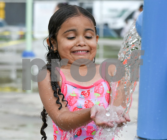 072017 Wesley Bunnell | Staff Janiah Calcano, age 4, plays at the Chesley Park Splash Pad on Thursday afternoon.
