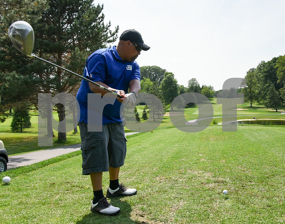 072117 Wesley Bunnell | Staff The Boys and Girls Club of New Britain held the 13th Annual Chuck Roby Golf Tournament, sponsored by Farmington Bank, on Friday at Stanley Golf Course. Christopher Roby prepares to tee off.