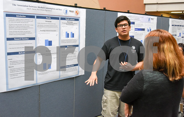 072117 Wesley Bunnell | Staff Middle and High School students completed a two week CCSU TRiO program with presentations and awards on Friday afternoon. Jose E. Garcia explains his research project on alcohol consumption and race.