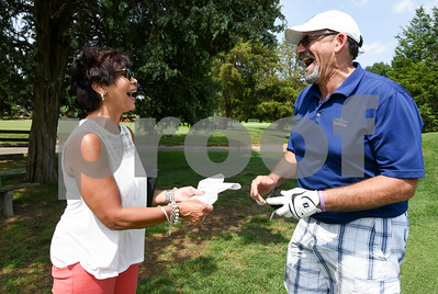 072117  Wesley Bunnell   Staff  The Boys and Girls Club of New Britain held the 13th Annual Chuck Roby Golf Tournament, sponsored by Farmington Bank,  on Friday at Stanley Golf Course. Lynn Roby Knapp, L, enjoys a laugh with tournament participant Ron Albert as he buys 50/50 raffle tickets.