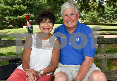 072117  Wesley Bunnell   Staff  The Boys and Girls Club of New Britain held the 13th Annual Chuck Roby Golf Tournament, sponsored by Farmington Bank,  on Friday at Stanley Golf Course. Lynn Roby Knapp poses with Bob Heath.