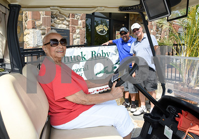 072117  Wesley Bunnell   Staff  The Boys and Girls Club of New Britain held the 13th Annual Chuck Roby Golf Tournament, sponsored by Farmington Bank,  on Friday at Stanley Golf Course. Chuck Roby's wife Helen Roby sits in a golf cart with Christopher Roby and Chuck Roby Jr. in the background.