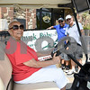 072117  Wesley Bunnell | Staff<br /> <br /> The Boys and Girls Club of New Britain held the 13th Annual Chuck Roby Golf Tournament, sponsored by Farmington Bank,  on Friday at Stanley Golf Course. Chuck Roby's wife Helen Roby sits in a golf cart with Christopher Roby and Chuck Roby Jr. in the background.