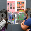 072117  Wesley Bunnell | Staff<br /> <br /> Middle and High School students completed a two week CCSU TRiO program with presentations and awards on Friday afternoon. Michelle Montero, L, and partner Julyssa Garcia look over their project on deep sea exploration.
