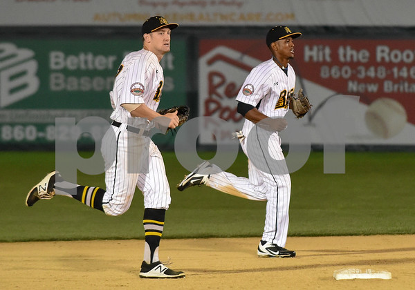 072417 Wesley Bunnell   Staff The New Britain Bees lost 2-1 to the Lancaster Barnstormers on Monday evening. Conor Bierfeldt (28), runs off the field with Jordan Hinshaw (19).
