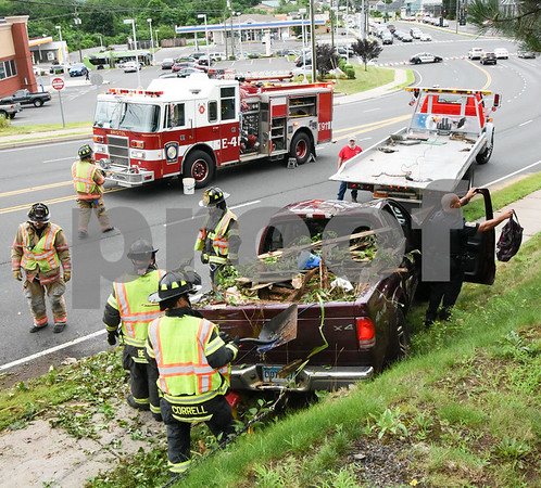 072417 Wesley Bunnell   Staff Emergency crews responded to a pick up truck rollover on Mountain Rd in Bristol on Monday afternoon. A view looking down Mountain Rd.