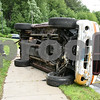 072417  Wesley Bunnell | Staff<br /> <br /> Emergency crews responded to a pick up truck rollover on Mountain Rd in Bristol on Monday afternoon. A police officer takes photos of the truck.