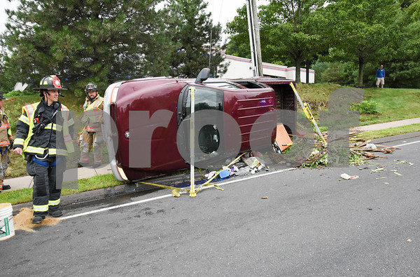 072417 Wesley Bunnell   Staff Emergency crews responded to a pick up truck rollover on Mountain Rd in Bristol on Monday afternoon.