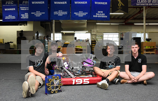 072417 Wesley Bunnell   Staff Members of the Cyber Knights, Southington High School's robotics team, pose with their trophy from their recent victory. Andrew Bauer, L, Stephen Rutkowski, Ryan Monte and Chris Bonomi.