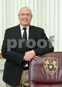 072517  Wesley Bunnell | Staff  Berlin's Police Chief Paul Fitzgerald on Tuesday afternoon in his office.