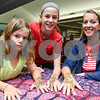 072517  Wesley Bunnell | Staff<br /> <br /> Brooke, age 8, Paige, age 11, and their mother Keri Kemish after having henna applied to their hands by Jamilah Zebarth at the Berlin-Peck Memorial Library on Tuesday evening.