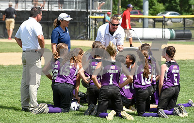 072617  Wesley Bunnell | Staff  New York defeated Pennsylvania in a 2017 Little League Softball Eastern Regional Tournament game on Wednesday afternoon. The New York team with a post game meeting.