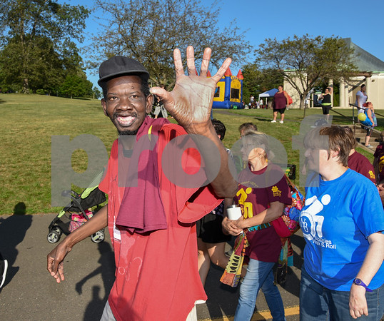 072617 Wesley Bunnell | Staff The 10th Annual Abilities/disabilities Walk and Roll celebrating the American Disabilities Act of 1980 took place on Wednesday evening at Walnut Hill Park. A walker waves as he starts the beginning of the event.