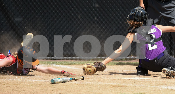 072617 Wesley Bunnell | Staff New York defeated Pennsylvania in a 2017 Little League Softball Eastern Regional Tournament game on Wednesday afternoon. New York catcher Emma Lawson (2) is unable to tag the Pennsylvania runner at home.