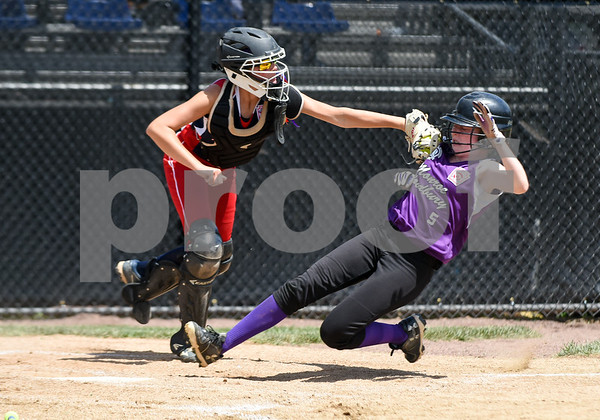 072617 Wesley Bunnell | Staff New York defeated Pennsylvania in a 2017 Little League Softball Eastern Regional Tournament game on Wednesday afternoon. Pennsylvania catcher Rowan Mulholland (19) tags New York's Lindsay Sundheimer (5) in time for the out.