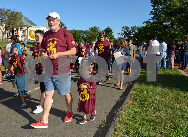 072617 Wesley Bunnell   Staff The 10th Annual Abilities/disabilities Walk and Roll celebrating the American Disabilities Act of 1980 took place on Wednesday evening at Walnut Hill Park. Representative William Petit Jr walks with his son William Petit III.
