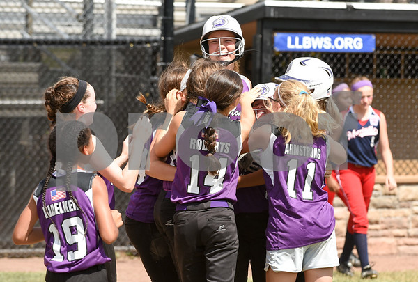072617 Wesley Bunnell | Staff New York defeated Pennsylvania in a 2017 Little League Softball Eastern Regional Tournament game on Wednesday afternoon. The New York team celebrates their win.