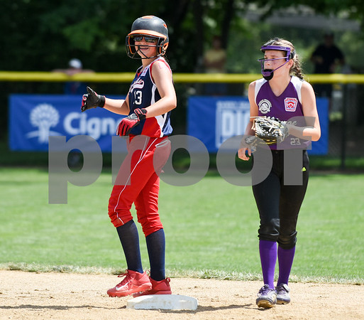 072617 Wesley Bunnell | Staff New York defeated Pennsylvania in a 2017 Little League Softball Eastern Regional Tournament game on Wednesday afternoon. Pennsylvania's Caitlyn Martell (13) reacts after hitting a double.