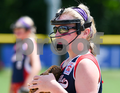 072617  Wesley Bunnell | Staff  New York defeated Pennsylvania in a 2017 Little League Softball Eastern Regional Tournament game on Wednesday afternoon. The first base line is reflected in the sunglasses of Pennsylvania's Katey Brennan (5).