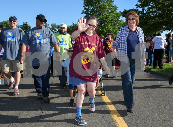 072617 Wesley Bunnell | Staff The 10th Annual Abilities/disabilities Walk and Roll celebrating the American Disabilities Act of 1980 took place on Wednesday evening at Walnut Hill Park. A walker waves as she starts the beginning of the event.