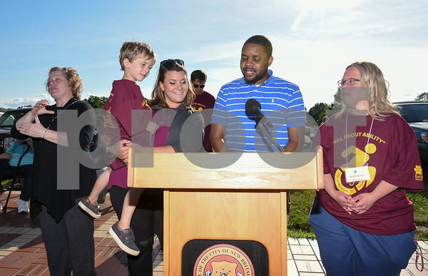 072617 Wesley Bunnell   Staff The 10th Annual Abilities/disabilities Walk and Roll celebrating the American Disabilities Act of 1980 took place on Wednesday evening at Walnut Hill Park. Mayor Erin Stewart holds William Petit III during her speech with Alderman Jerrell Hargraves and Alicia Rostkowski.