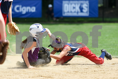 072617  Wesley Bunnell | Staff  New York defeated Pennsylvania in a 2017 Little League Softball Eastern Regional Tournament game on Wednesday afternoon.  Pennsylvania's Ella Visco (3) tags the New York runner.