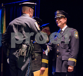 072717  Wesley Bunnell | Staff  The 13th Training Session of the Regional Satellite Basic Recruit Academy graduated on Thursday afternoon at Trinity-on-Main in New Britain. New Britain Police Chief James Wardwell shakes the hand of a new officer.