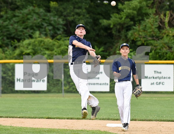 072817 Wesley Bunnell | Staff Newington vs Ellington in a Little League state finals game played at Adams Middle School in Guilford. Shaun Callahan (24) comes in on a ball hit to second and throws off balance to first base for the out.