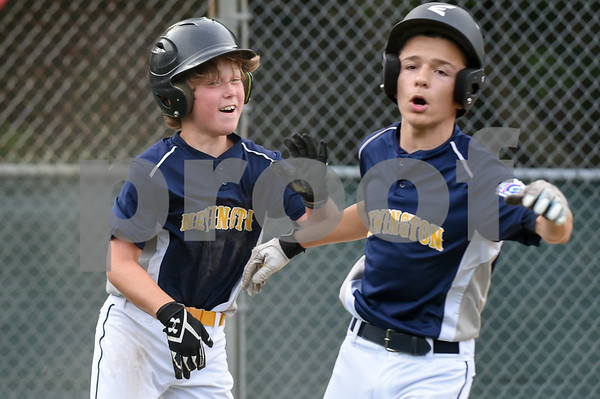 072817 Wesley Bunnell | Staff Newington vs Ellington in a Little League state finals game played at Adams Middle School in Guilford. Nick Gagliardi (1) L, congratulates teammate Alex Cappellucci (2) after the pair scored a couple of runs for Newington.