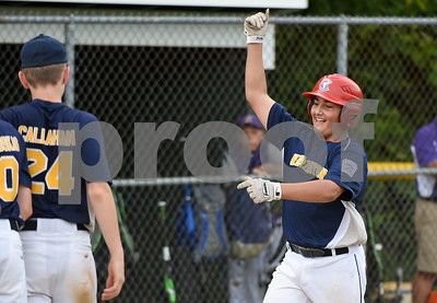 072817  Wesley Bunnell | Staff  Newington vs Ellington in a Little League state finals game played at Adams Middle School in Guilford. Gabby Tirado (21) motions to teammates waiting for him at home plate after hitting a home run to right.