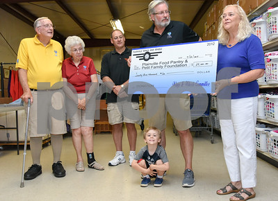 073117  Wesley Bunnell | Staff  Plainville Wings and Wheels presented a check to benefit the Plainville Community Food Pantry and the Petit Family Foundation on Monday evening at the Plainville Community Food Pantry. From L William Petit, Barbara Petit, Committee member for Wings and Wheels Scott Saunders, William Petit Jr. President of the Board of Directors for the Plainville Community Food Pantry Maggie Carlin with William Petit III sitting.