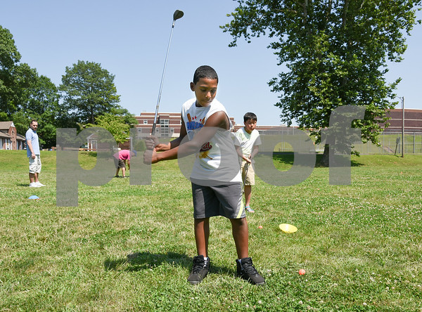 073117 Wesley Bunnell | Staff Julian Martinez, age 12, takes a swing on Monday afternoon during golf class as part of the Extreme Summer Program. The program is through the New Britain Board of Education.