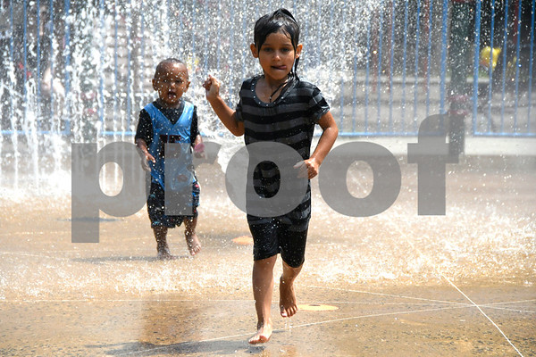 7/11/2017 Mike Orazzi   Staff Malka and Araynna Beland while cooling off in the Rockwell Park spray park Tuesday afternoon.