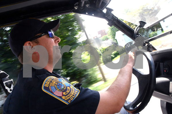 7/11/2017 Mike Orazzi   Staff Bristol police officer George Franek while on patrol in the police explorer's John Deere Gator Tuesday.