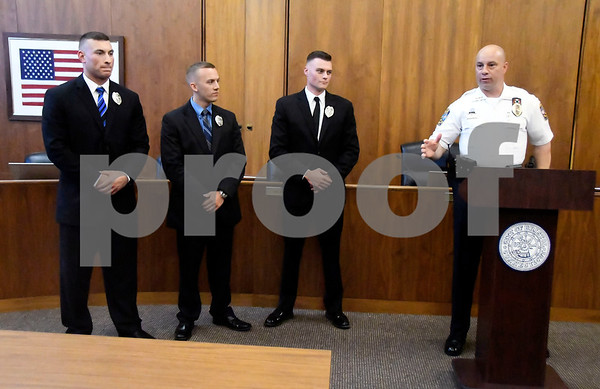 7/12/2017 Mike Orazzi   Staff Bristol's newest police recruits, Zach Rodriguez, Chris Bordner,and Travis Martin as police chief Brian Gould welcomes them during a short ceremony Wednesday at city hall.