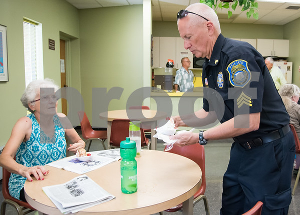 071217 Wesley Bunnell   Staff New Britain TRIAD served up ice cream at the New Britain Senior Center on Wednesday afternoon. New Britain Police Sgt. Art Powers serves Christine Guillette.