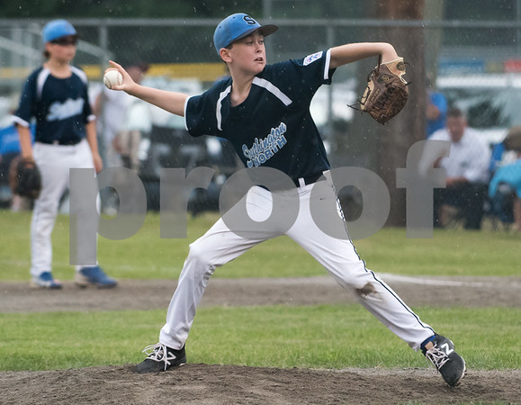 071217 Wesley Bunnell   Staff The Little League age 10-11 District 5 Championship game was played at Trumbull Park in Plainville featuring Southington North vs Wallingford. Kyle Martin (6) pitching in relief in the second inning.