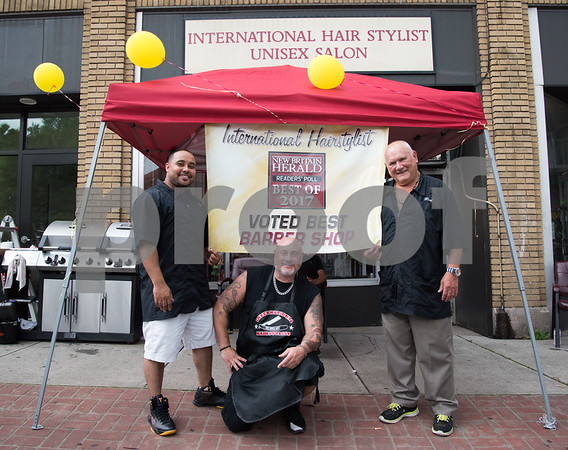 071217 Wesley Bunnell   Staff International Hair Stylist celebrated winning a Best Of award from the New Britain Herald on Wednesday afternoon. Javier Cruz, L, Herbie Holter Jr. & Herbert Holter Sr.