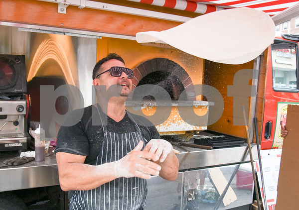 071217 Wesley Bunnell   Staff The first farmers market of the year in Central Park took place on Wednesday featuring local businesses and pizza truck. Frank Bernardo Sr. of the New Haven Pizza Truck hand tosses pizza dough.