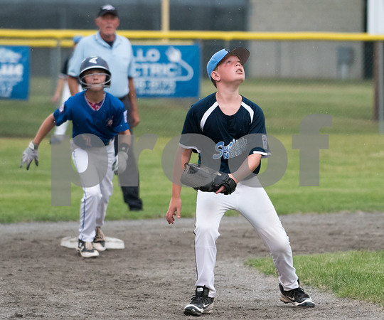 071217 Wesley Bunnell   Staff The Little League age 10-11 District 5 Championship game was played at Trumbull Park in Plainville featuring Southington North vs Wallingford. SS Kyle Crispens (11) watches a fly ball head towards left center.