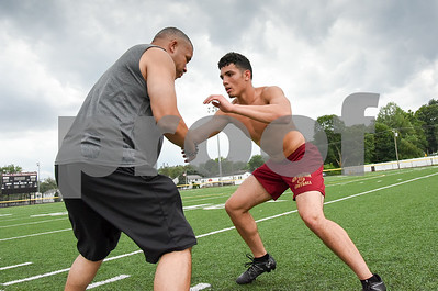 071317  Wesley Bunnell | Staff  New Britain High School alumn and incoming freshman at American International University Alex Silva works out with his father Elvin at Chesley Park on Thursday under dark skies.