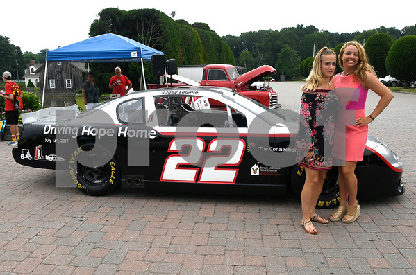 7/13/2017 Mike Orazzi | Staff Madison Yurgaitis and Lindsey Fritz pose in front of Joey Logano's race car parked at the Aqua Turf Club for Driving Hope Home, the annual Joey Logano Foundation (JLF) charity event in Connecticut Thursday afternoon.