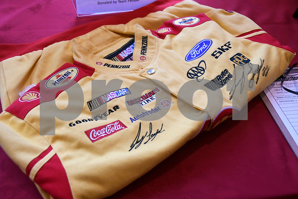 7/13/2017 Mike Orazzi | Staff Joey Logano's fire suit in the silent auction at the Aqua Turf Club for Driving Hope Home, the annual Joey Logano Foundation (JLF) charity event in Connecticut Thursday afternoon.