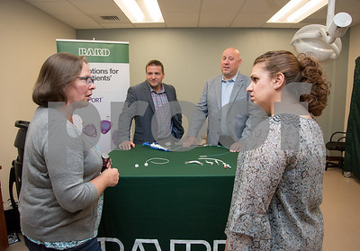 071317  Wesley Bunnell | Staff  Starling Access celebrated the opening of its newest location at 505 Willard Ave in Newington. Clinic Manager of American Renal Associates in New Britain Dawn Mapp, L and Starling Administrative Assistant Valerie Johnson speak with Matt Hayes and Greg Genoa of Bard Peripheral.