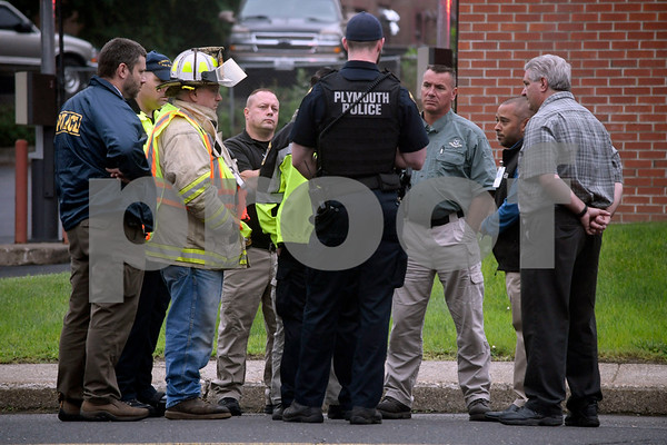 7/14/2017 Mike Orazzi | Staff The where a white powder was found in a U.S Postal Service mailbox on Agney Avenue behind Thomaston Savings Bank Friday afternoon. The street was closed for several hours as state DEEP officials, Plymouth Police and Fire along with a regional postal inspector responding to the scene.