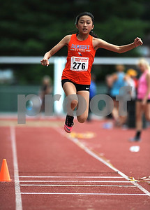 7/15/2017 Mike Orazzi | Staff Meilee Kry during the triple jump at the Nutmeg Games held in Willow Brook Park in New Britain Saturday.