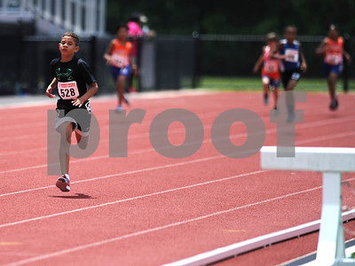 7/15/2017 Mike Orazzi | Staff Brandon Tavares running the 400 meter during the Nutmeg Games held in Willow Brook Park in New Britain Saturday.