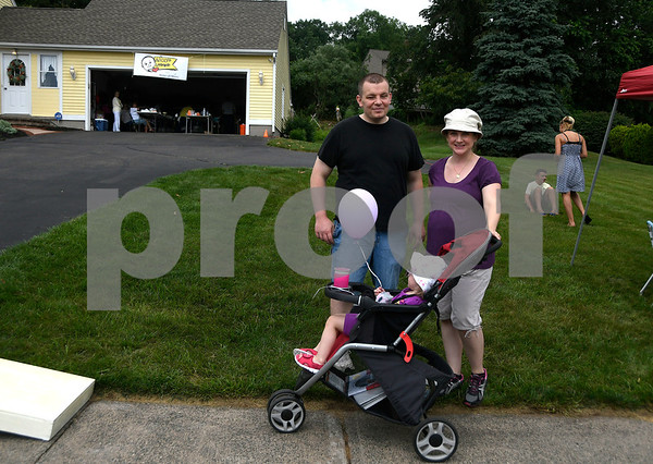 7/15/2017 Mike Orazzi | Staff Shem and Violette Skalaski with their daughter Lydia,2, during Nicos Lemonade Stand fundraiser on Northwest Drive in Plainville Saturday.